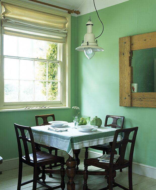 Dining table with green painted walls