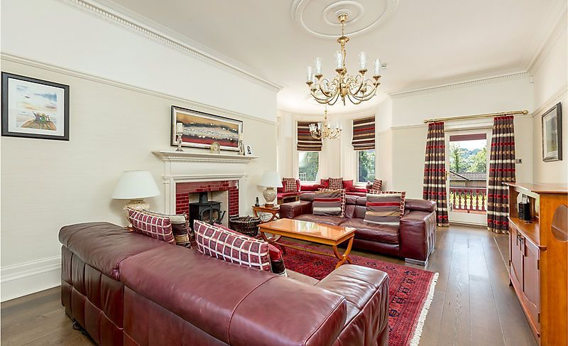 Painted living room with dark red leather sofa